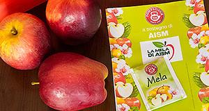 Foto delle mele e delle bustine di tisane alle mele dell'AISM per la ricerca contro la sclerosi multipla